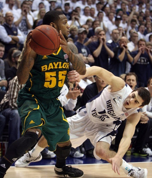 Steve Griffin     The Salt Lake Tribune  BYU's Matt Carlino slips down as he tries to trap Byalor's Pierre Jackson in the corner of the court during second half action of the BYU Baylor basketball game  in Provo, Utah Saturday, December 17, 2011.