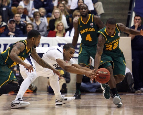 Steve Griffin     The Salt Lake Tribune   Baylor's  Pierre Jackson, left, and A.J. Walton strip the ball from BYU's Brandon Davies preventing him from taking another shot as time expires giving Baylor the win at the Marriott Center in Provo, Utah Saturday, December 17, 2011.