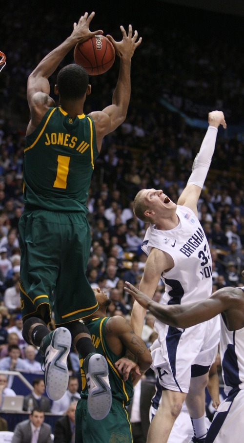 Steve Griffin     The Salt Lake Tribune  BYU's MAte Austin can't stop a lob pass as Byalor's Perry Jones III leaps towards the basket during frist half action of the BYU Baylor basketball game  in Provo, Utah Saturday, December 17, 2011.