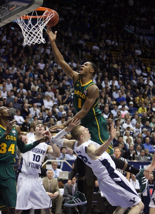 Steve Griffin     The Salt Lake Tribune  BYU's Nate AUstin draws a charging foul on Baylor's Perry Jones III during frist half action of the BYU Baylor basketball game  in Provo, Utah Saturday, December 17, 2011.
