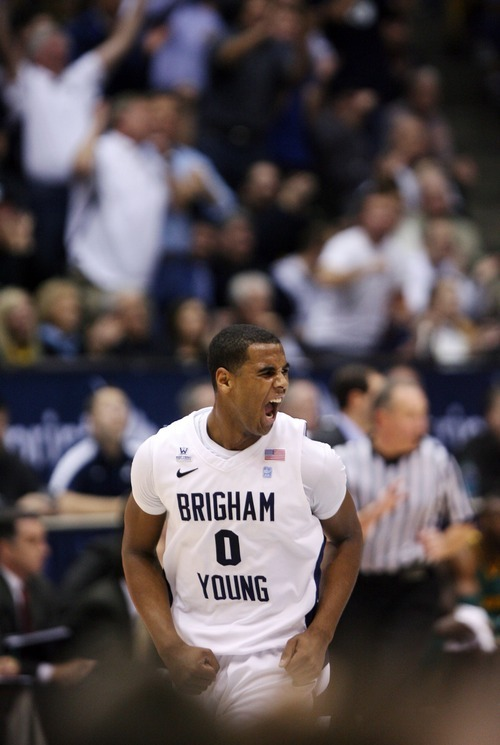 Steve Griffin     The Salt Lake Tribune  BYU's Brandon Davies screams with excitement as BYU pulls away from Baylor during frist half action of the BYU Baylor basketball game  in Provo, Utah Saturday, December 17, 2011.