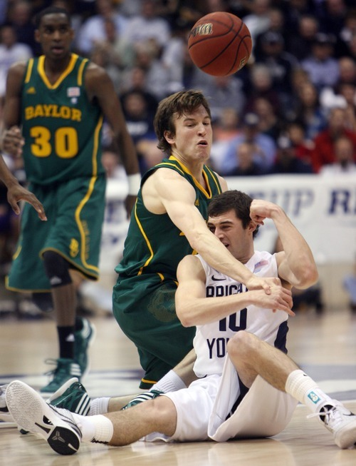 Steve Griffin  |  The Salt Lake Tribune  BYU's Matt Carlino fires the ball over his had as he battles Baylor's Brady Heslip during frist half action of the BYU Baylor basketball game  in Provo, Utah Saturday, December 17, 2011.