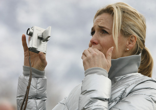 Rick Egan   |  The Salt Lake Tribune  Julie Reneer sheds a tear as she watches the the Provo Tabernacle go down in flames, Friday, December 17, 2010.  Reneer, a native of Provo, has been attending church services in the building since she was a small child.