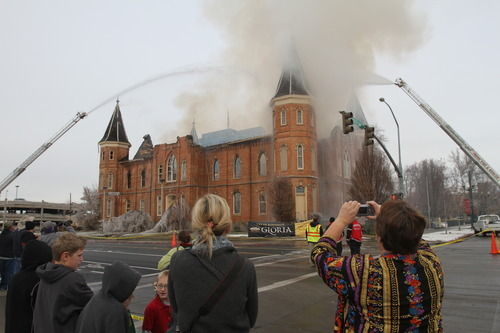 Rick Egan   |  The Salt Lake Tribune  Crowds gather to take photos of the Provo Tabernacle, as flames still burned inside, around noon, Friday, December 17, 2010.