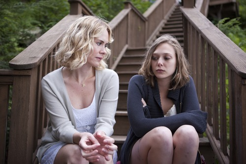 Sarah Paulson (left) and Elizabeth Olsen play sisters in the drama