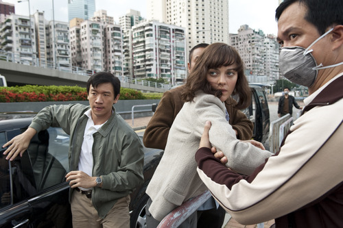 Chin Han, left, and Marion Cotillard are shown in a scene from the film