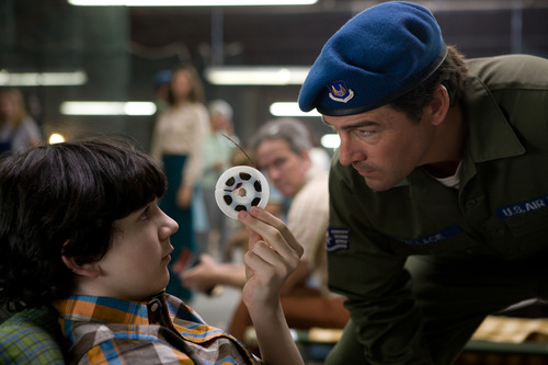 In this film publicity image released by Paramount Pictures, Zack Mills, left, and Kyle Chandler are shown in a scene from