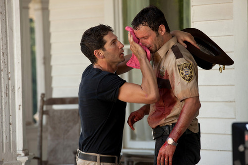 In this image released by AMC, actors Jon Bernthal, left, and Andrew Lincoln appear in a scene from the second season of the AMC original series,
