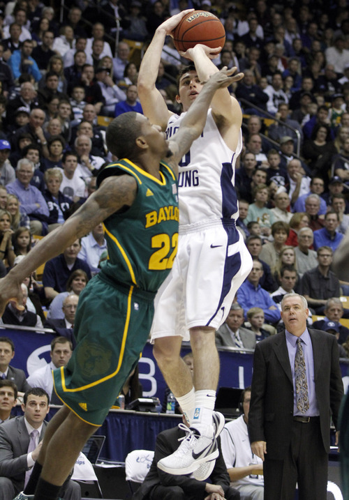 BYU guard Matt Carlino (10) shoots over Baylor guard A.J. Walton (22) during the second half of an NCAA college basketball game, Saturday, Dec. 17, 2011, in Provo, Utah. Baylor won 86-83. (AP Photo/Jim Urquhart)