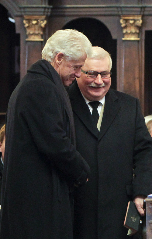 Former President Bill Clinton shakes hand with former Polish President Lech Walesa as he arrives for the state funeral of former Czech President Vaclav Havel in the St. Vitus Cathedral in Prague, Friday, Dec. 23, 2011. Havel died Sunday, Dec. 18, at age 75. (AP Photo/Markus Schreiber)