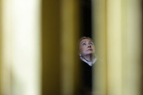 Secretary of State Hillary Clinton is seen between columns near the altar during the state funeral of former Czech President Vaclav Havel in the St. Vitus Cathedral in Prague on Friday, Dec. 23, 2011. Havel died Sunday, Dec. 18, at age 75. (AP Photo/Markus Schreiber)