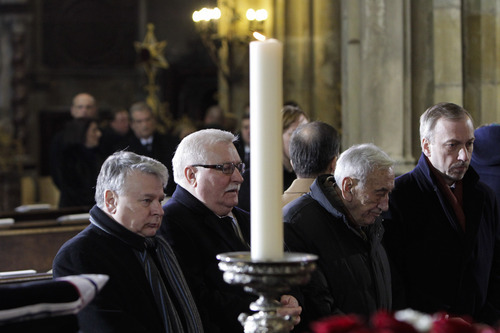 Poland's opposition leader Jaroslaw Kaczynski, left, and Poland's former President Lech Walesa, second left, attend the state funeral of former Czech President Vaclav Havel in the St. Vitus Cathedral in Prague, Friday, Dec. 23, 2011. Havel died Sunday, Dec. 18, at age 75. (AP Photo/Markus Schreiber)