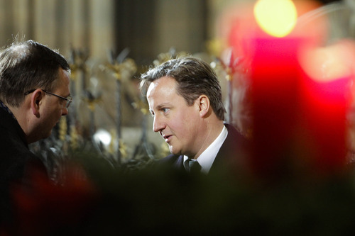 British Prime Minister David Cameron, right, shakes hands with Czech Prime Minister Petr Necas during the state funeral of former Czech President Vaclav Havel in the St. Vitus Cathedral in Prague on Friday, Dec. 23, 2011. Havel died Sunday, Dec. 18, at age 75. (AP Photo/Markus Schreiber)