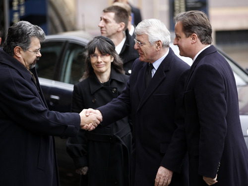 Former British Prime Minister John Major, second right, and Prime Minister David Cameron, right, arrive for the state funeral of former Czech President Vaclav Havel in the St. Vitus Cathedral in Prague on Friday, Dec. 23, 2011. Havel died Sunday, Dec. 18, at age 75. (AP Photo/Michael Sohn)