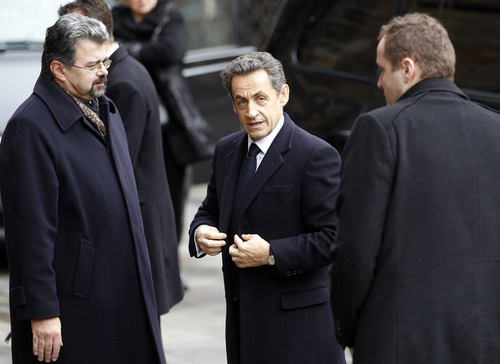 Jiri Weigel, Chancellor of the Prague Castle, left, welcomes French President Nicolas Sarkozy, center, prior to the state funeral of former Czech President Vaclav Havel in the St. Vitus Cathedral in Prague on Friday, Dec. 23, 2011. Havel died Sunday, Dec. 18, at age 75. (AP Photo/Michael Sohn)