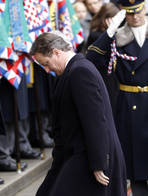 Britains Prime Minister David Cameron arrives for the state funeral of former Czech President Vaclav Havel in the St. Vitus Cathedral in Prague on Friday, Dec. 23, 2011. Havel died Sunday, Dec. 18, at age 75. (AP Photo/Michael Sohn)
