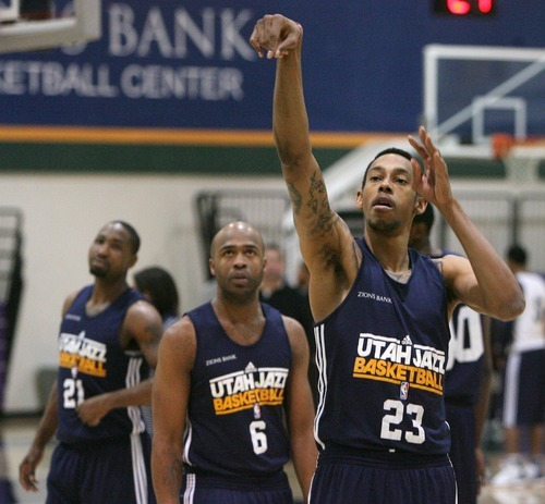Steve Griffin  |  The Salt Lake Tribune  (left to right) Keith McLeod, Jamaal Tinsley and Try Glider warm up prior to practice at the Jazz practice facility  in Salt Lake City, Utah Monday, December 12, 2011.