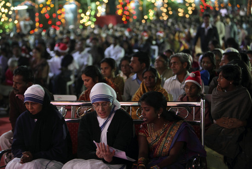 Indian Christians sing during Christmas prayers at St. Mary's church in Hyderabad, India, Sunday, Dec.25, 2011. (AP Photo/Mahesh Kumar A.)