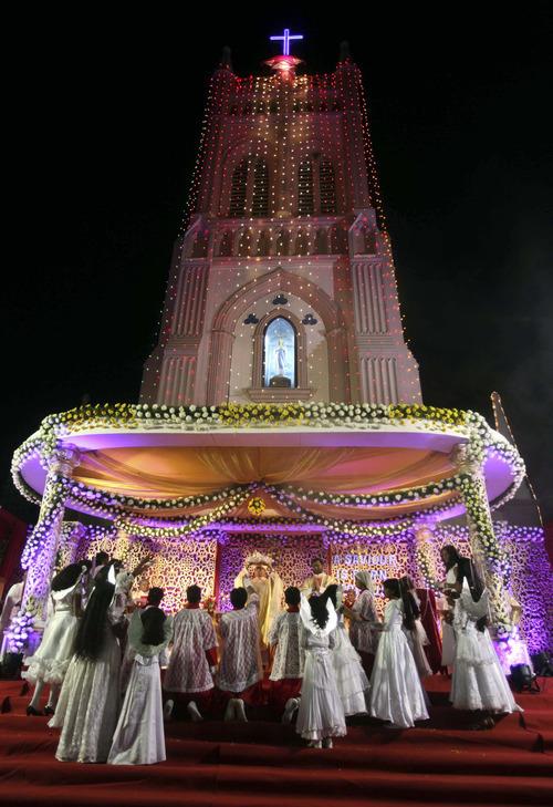 Worshippers celebrate Christmas at St. Mary's church in Hyderabad, India, Sunday, Dec.25, 2011. (AP Photo/Mahesh Kumar A.)