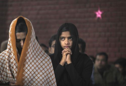 Devotees pray in a church on Christmas, in New Delhi, India, Sunday, Dec. 25, 2011.  (AP Photo/Manish Swarup)