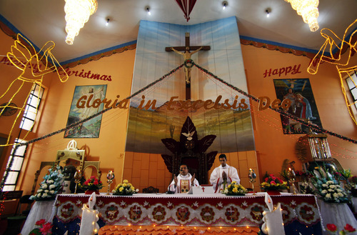 Priests perform rituals during Christmas at St. Mary's Garrison church, in Jammu, India, Sunday, Dec.25,2011. Christmas Day is observed as a national holiday in India. (AP Photo/Channi Anand)