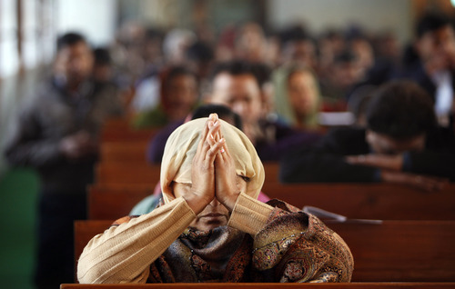 Christian devotees pray at the St. Mary's Garrison church on Christmas in Jammu, India, Sunday, Dec. 25, 2011. Christmas Day is observed as a national holiday in India. (AP Photo/Channi Anand)