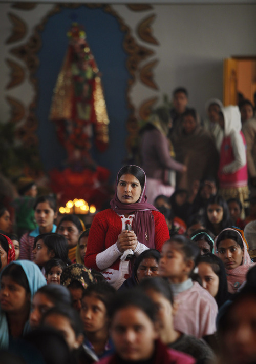 Christian devotees attend Christmas prayers at the St. Mary's Garrison church in Jammu, India, Sunday, Dec. 25, 2011. Christmas Day is observed as a national holiday in India. (AP Photo/Channi Anand)