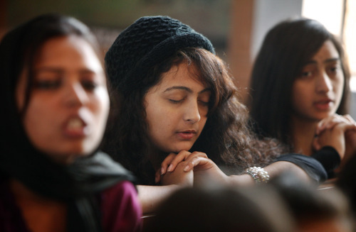 Christian devotees pray at the St. Mary's Garrison church in Jammu, India, Sunday, Dec. 25, 2011. Christmas Day is observed as a national holiday in India. (AP Photo/Channi Anand)
