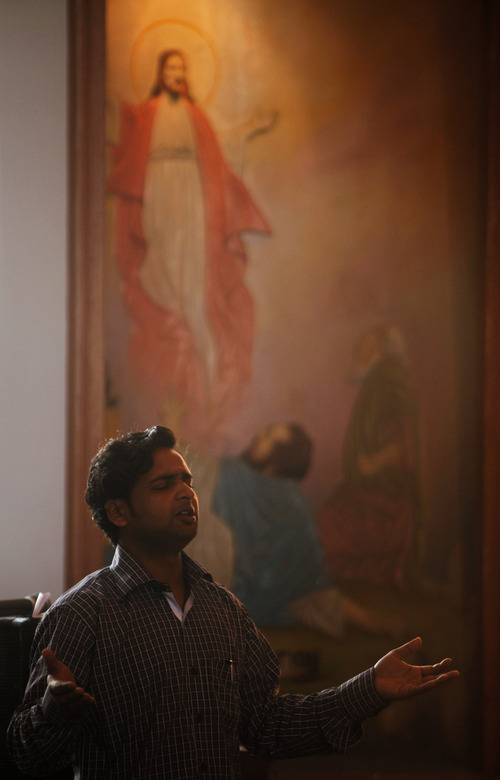 A Christian devotee prays at the St. Mary's Garrison church on Christmas, in Jammu, India, Sunday, Dec. 25, 2011. Christmas Day is observed as a national holiday in India. (AP Photo/Channi Anand)