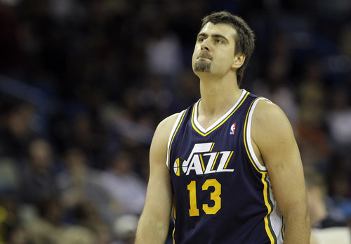 Utah Jazz center Mehmet Okur, of Turkey, reacts after Utah lost possession of the ball to the New Orleans Hornets in the second half of an NBA basketball game in New Orleans, Friday, Dec. 17, 2010. New Orleans defeated Utah 100-71. (AP Photo/Patrick Semansky)