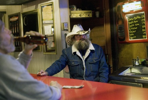 Kim Raff   The Salt Lake Tribune Larry Moyes works behind the bar at Swedetown Pub in Salt Lake City.