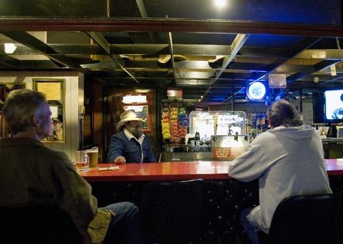 Kim Raff   The Salt Lake Tribune Patrons of Swedetown Pub watch tv at the bar in Salt Lake City.