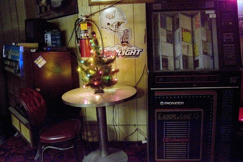 Kim Raff   The Salt Lake Tribune A small Christmas tree sits on a table next to a juke box and cigarette machine in Swedetown Pub in Salt Lake City.