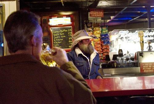 Kim Raff   The Salt Lake Tribune Larry Moyes (center) works behind the bar at Swedetown Pub in Salt Lake City on Dec. 21.