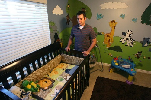 Leah Hogsten  |  The Salt Lake Tribune Jake Strickland of South Jordan stands in what was to be his son's nursery, designed by his mother Jennifer Graham. He is waging a legal battle to get custody of his son, born Dec. 29, 2010 and placed for adoption a day later.