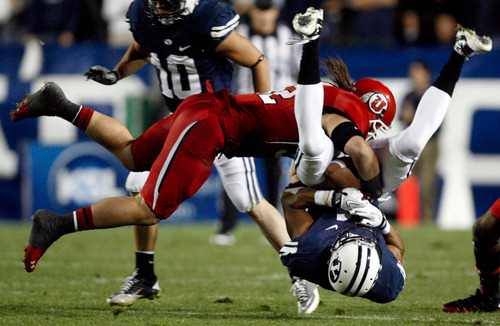 Trent Nelson  |  The Salt Lake Tribune Utah's Chaz Walker makes a tackle against Utah at LaVell Edwards Stadium in Provo on Saturday, Sept. 17, 2011.