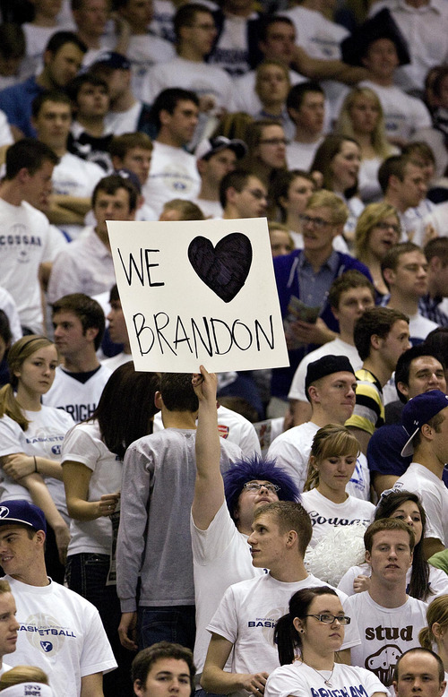 Djamila Grossman  |  The Salt Lake Tribune  Brigham Young University plays New Mexico in Provo on Wednesday, March 2, 2011. BYU fans hold up a sign in reaction to player Brandon Davies, who was kicked off the team for a BYU honor code violation.
