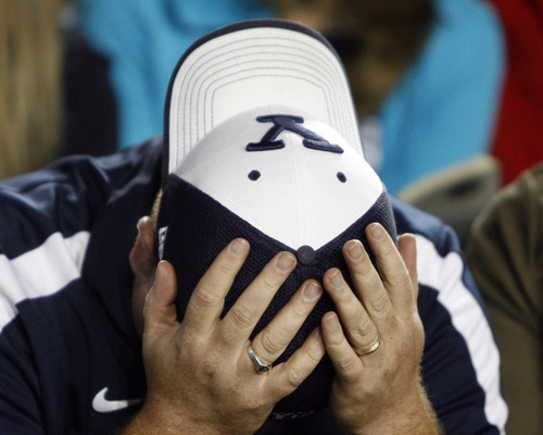 Rick Egan  | The Salt Lake Tribune   A BYU fan near the end of the 54-10  loss to Utah in football,  Saturday, Sept. 17, 2011.