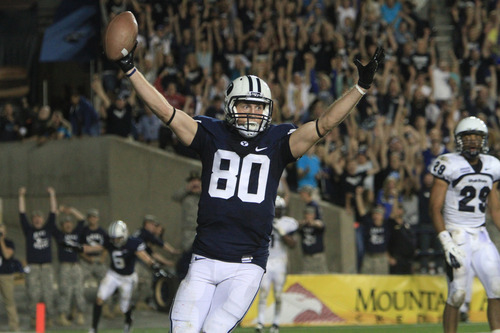 Rick Egan  | The Salt Lake Tribune   Brigham Young Cougars tight end Marcus Mathews (80) celebrates the winning touchdown as BYU  defeated Utah State, 27-24, on this touchdown pass with 11 seconds left in the game,  in Provo, Friday, Sept. 30, 2011.