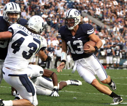 Rick Egan  | The Salt Lake Tribune   Brigham Young Cougars quarterback Riley Nelson (13) runs for the end zone but comes up short, in football action against Utah State,  in Provo, Friday, Sept. 30, 2011.  Utah State Aggies linebacker Kyle Gallagher (43) also is pictured.