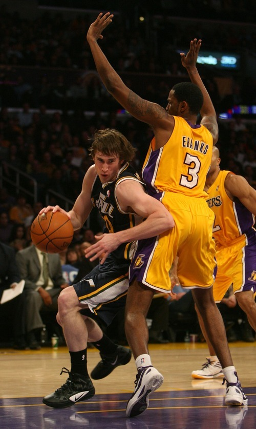 Steve Griffin  |  The Salt Lake Tribune  Utah's Gordon Hayward spins around Devin Ebanks, of the Lakers,  during first half action in the Jazz Lakers game at the Staples Center in  in Los Angeles, CA Tuesday, December 27, 2011.