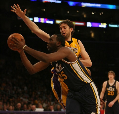 Steve Griffin  |  The Salt Lake Tribune  Utah's All Jefferson drives past Pau Gasol during first half action in the Jazz Lakers game at the Staples Center in  in Los Angeles, CA Tuesday, December 27, 2011.