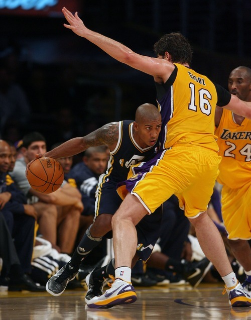 Steve Griffin  |  The Salt Lake Tribune  Utah's Raja Bell tries to get around Pau Gasol during second half action in the Jazz Lakers game at the Staples Center in  in Los Angeles, CA Tuesday, December 27, 2011.