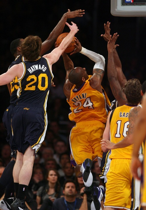 Steve Griffin  |  The Salt Lake Tribune  Utah's Al Jefferson and Gordon Hayward team up to block the shot of Kobe Bryant, of the Lakers, during first half action in the Jazz Lakers game at the Staples Center in  in Los Angeles, CA Tuesday, December 27, 2011.