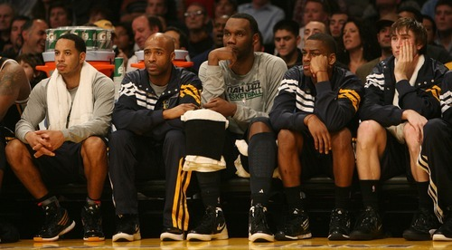 Steve Griffin     The Salt Lake Tribune  The Jazz bench can only watch as the Lakers open up a big lead during second half action in the Jazz Lakers game at the Staples Center in  in Los Angeles, CA Wednesday, December 28, 2011.