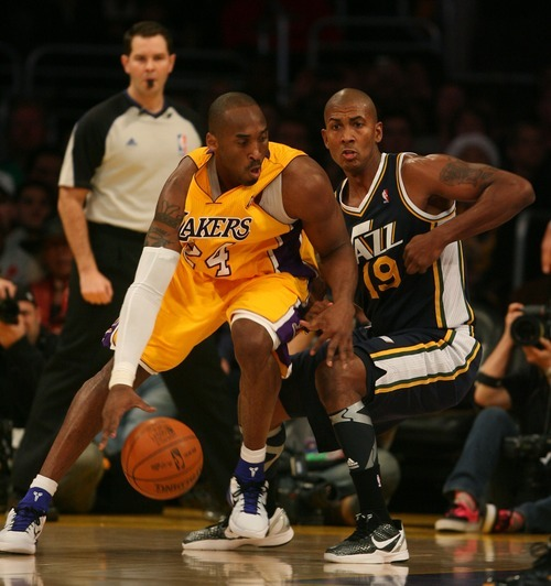 Steve Griffin  |  The Salt Lake Tribune  Utah's Raja Bell guards Kobe Bryant, of the Lakers, during first half action in the Jazz Lakers game at the Staples Center in  in Los Angeles, CA Tuesday, December 27, 2011.