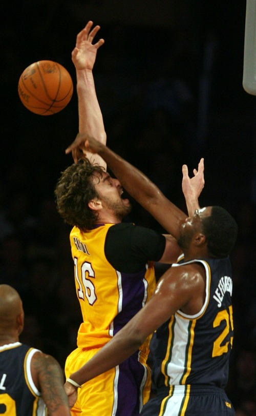 Steve Griffin  |  The Salt Lake Tribune  Utah's Al Jefferson blocks Pau Gasol's shot during first half action in the Jazz Lakers game at the Staples Center in  in Los Angeles, CA Tuesday, December 27, 2011.