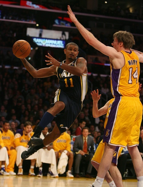 Steve Griffin  |  The Salt Lake Tribune  Utah's Earl Watson drives the baseline during first half action in the Jazz Lakers game at the Staples Center in  in Los Angeles, CA Tuesday, December 27, 2011.