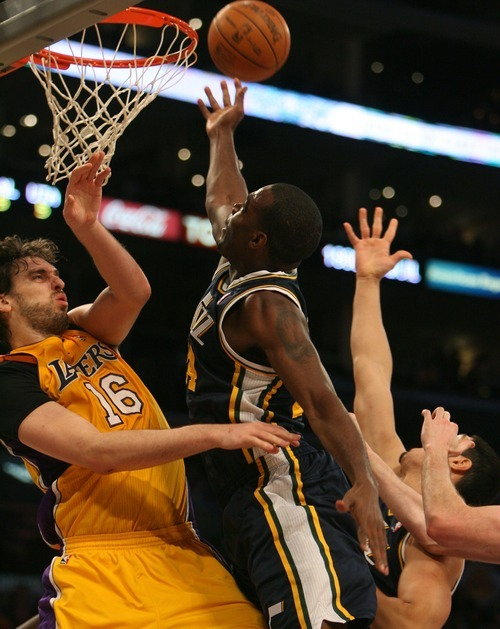 Steve Griffin  |  The Salt Lake Tribune  Utah's Paul Millsap crashes into Pau Gasol as he drives to the basket during first half action in the Jazz Lakers game at the Staples Center in  in Los Angeles, CA Tuesday, December 27, 2011.