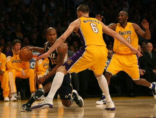 Steve Griffin  |  The Salt Lake Tribune  Utah's Raja Bell tries to dribble out of traffic during first half action in the Jazz Lakers game at the Staples Center in  in Los Angeles, CA Tuesday, December 27, 2011.